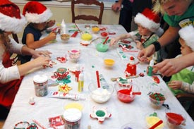 kids decorating cookies at the beyond wonderful decorating party - Christmas Cookie Decorating Party