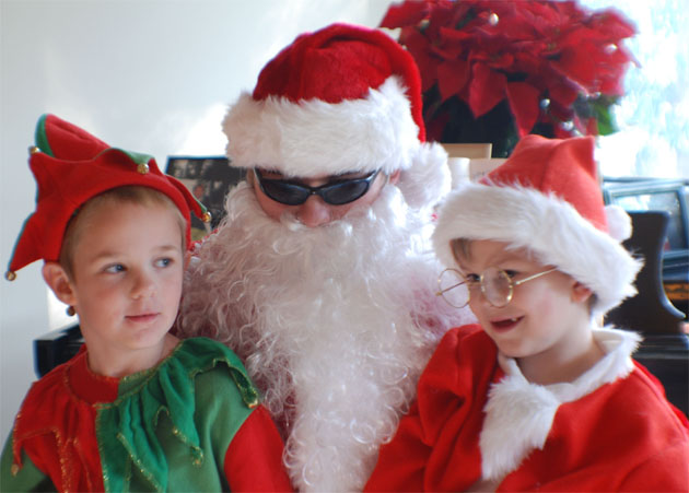 Santa with kids at Barbara Adams Beyond Wonderful Cookie Decorating Party.