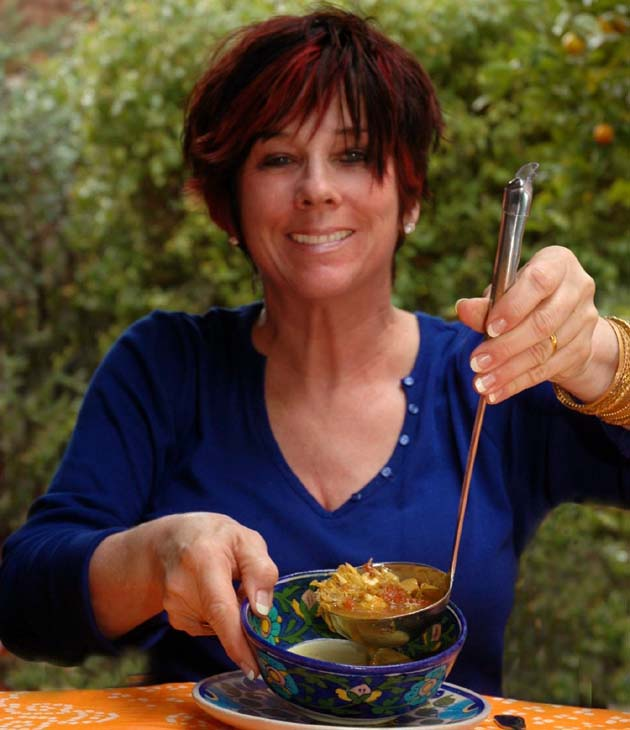 Barbara Adams ladeling Mulligatawny soup.