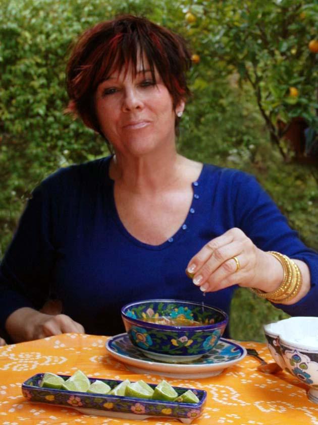 Barbara Adams spritzing limes into Mulligatawny soup.