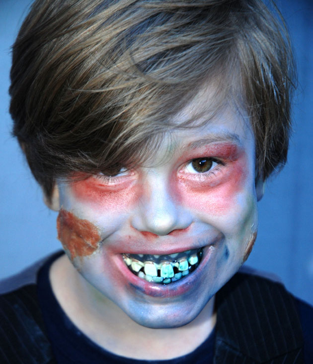 Zombie face paint makes the exploding cake even more fun.