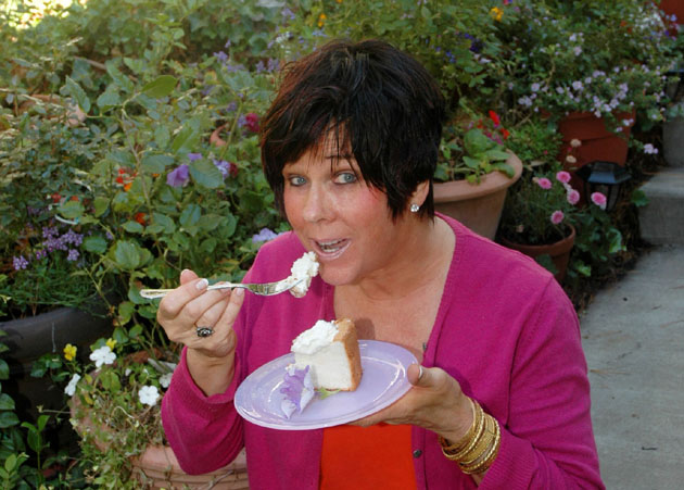 Barbara Adams eating angel food cake.