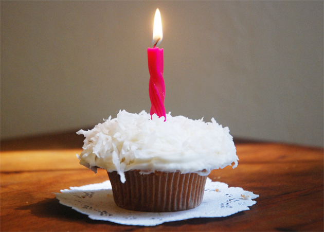 Coconut Cupcake with Ultimate Cream Cheese Frosting and Candle