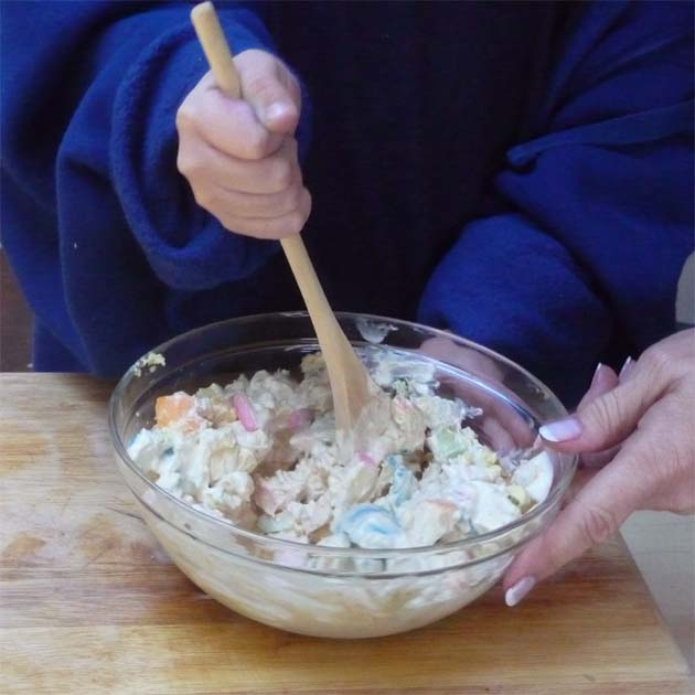 Mix Easter egg salad for sandwiches.